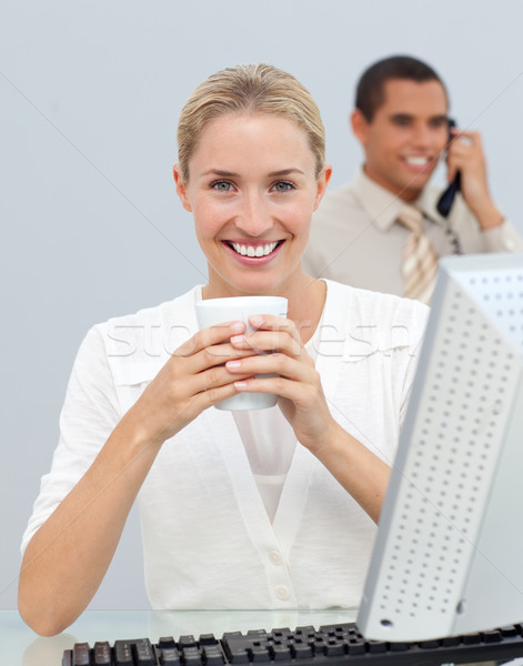 Stock photo: Blond woman drinking a coffee during the break