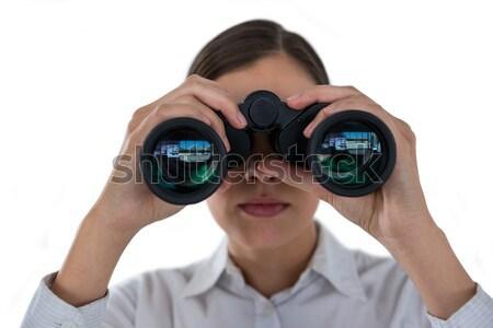 Surprised businesswoman looking through binoculars  Stock photo © wavebreak_media