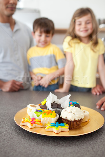 Enthusiastic family showing their handmade cookies Stock photo © wavebreak_media