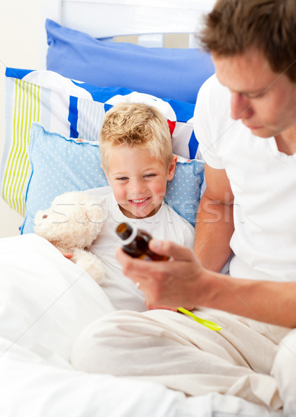 Caring man looking after his sick son Stock photo © wavebreak_media