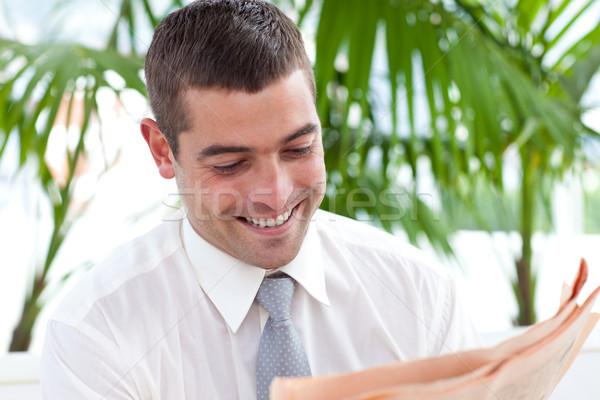 Businessman reading a newspaper in workplace Stock photo © wavebreak_media