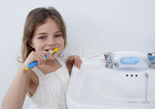 Portret meisje schoonmaken tanden badkamer vrouw Stockfoto © wavebreak_media