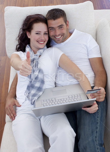 Couple buying online at home with thums up Stock photo © wavebreak_media
