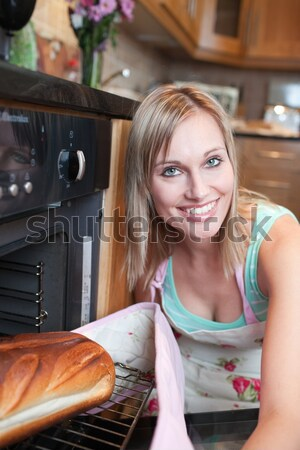 Cheerful blond woman baking bread  Stock photo © wavebreak_media