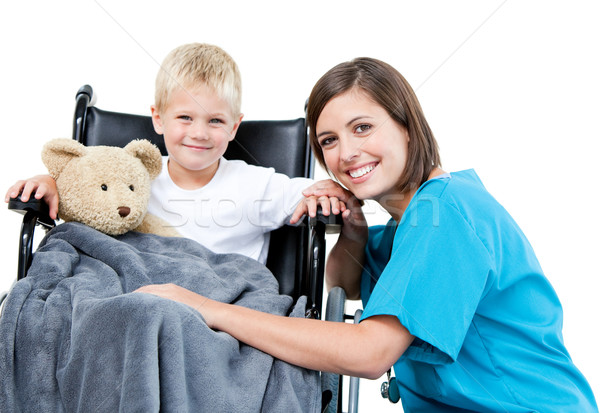 Nice female doctor carrying adorable little boy with his teddy b Stock photo © wavebreak_media