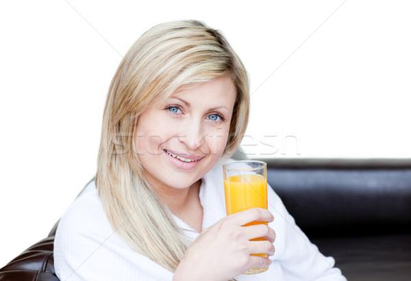 Smiling woman drinking an orange jus Stock photo © wavebreak_media