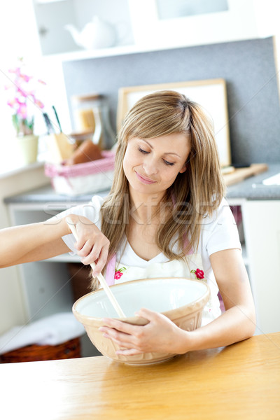 Portrait of a teen woman preparing a cake in the kitchen Stock photo © wavebreak_media