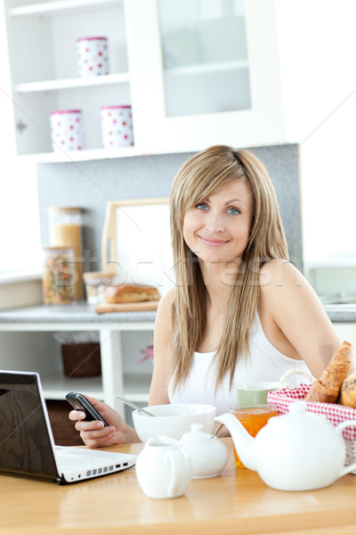 Cute woman having breakfast in the kitchen  Stock photo © wavebreak_media