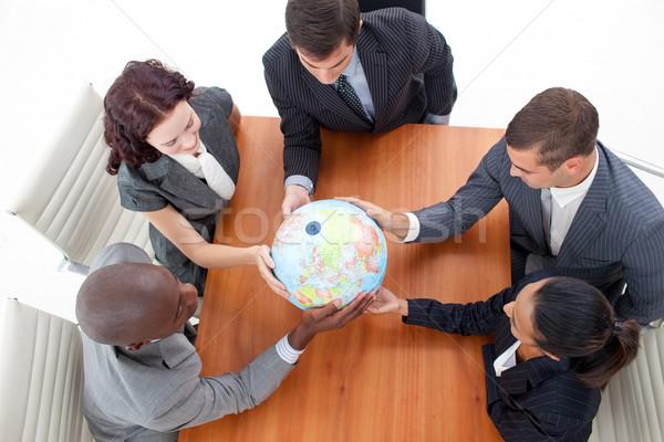 Gente de negocios mundo reunión negocio global Foto stock © wavebreak_media