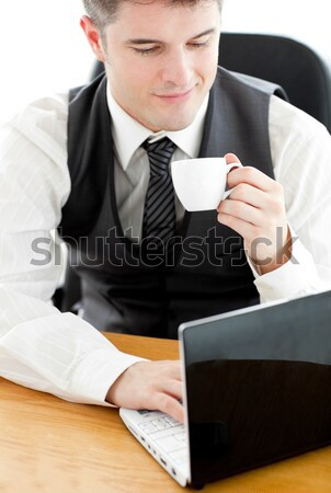 Radiant caucasian businesswoman holding a coffee sitting at her desk in her office Stock photo © wavebreak_media