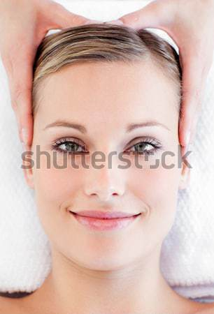 Portrait of a bright young woman receiving a head massage in a spa center Stock photo © wavebreak_media
