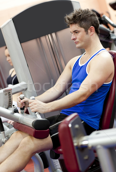Serious athletic man using a leg press  in the weights room of a sport centre Stock photo © wavebreak_media
