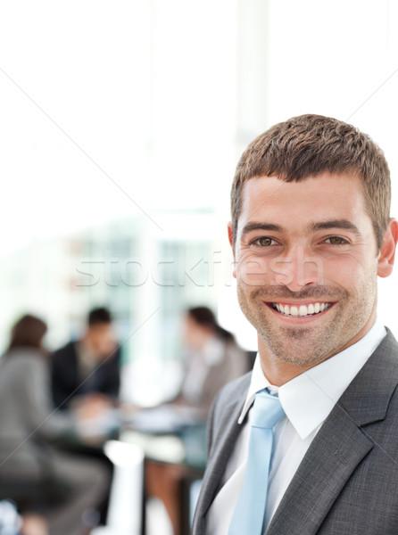 Feliz empresário reunião equipe edifício moderno trabalhando Foto stock © wavebreak_media