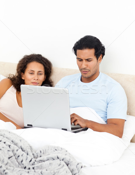 Passionné femme regarder mari travail portable Photo stock © wavebreak_media