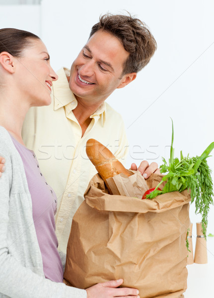 Lovely couple coming back from the market with vegetables in shopping bags Stock photo © wavebreak_media