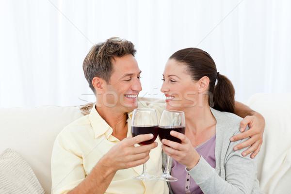 情熱的な カップル 飲料 赤ワイン リラックス ソファ ストックフォト © wavebreak_media
