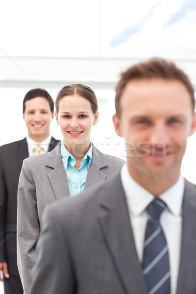 Young businesswoman posing with two businessmen in a row at work Stock photo © wavebreak_media