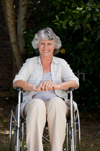 Smiling woman in her wheelchair Stock photo © wavebreak_media