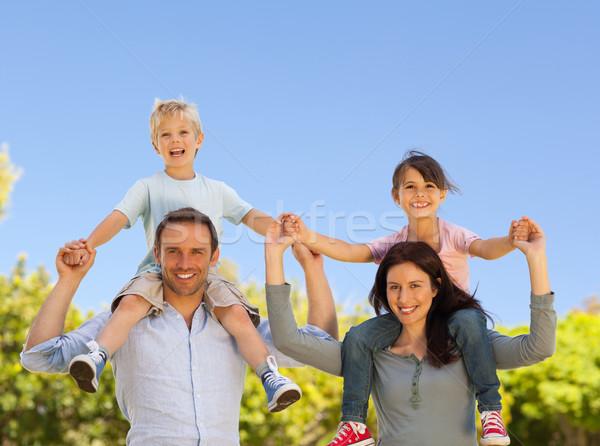 Parents giving  children a piggyback  Stock photo © wavebreak_media