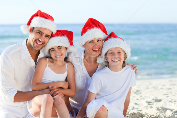 Family during Christmas day at the beach Stock photo © wavebreak_media