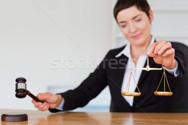 Serious judge with a gavel and the justice scale in her office Stock photo © wavebreak_media