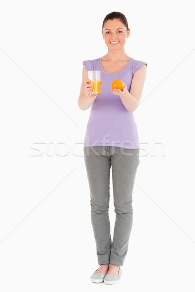 Stockfoto: Jonge · mooie · vrouw · oranje · glas · sinaasappelsap