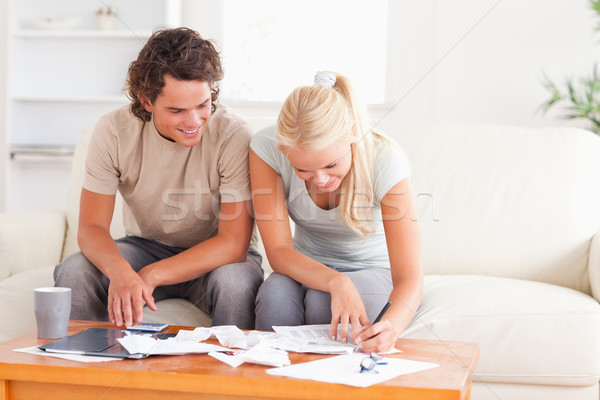 Smiling couple calculating their expenses in the living room Stock photo © wavebreak_media