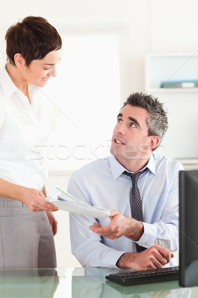 Portrait of a manager receiving a document from his secretary in his office Stock photo © wavebreak_media