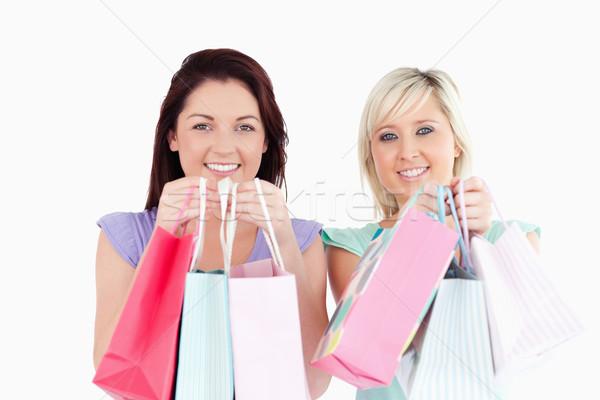 Zdjęcia stock: Uśmiechnięty · młodych · kobiet · studio · uśmiech · twarz