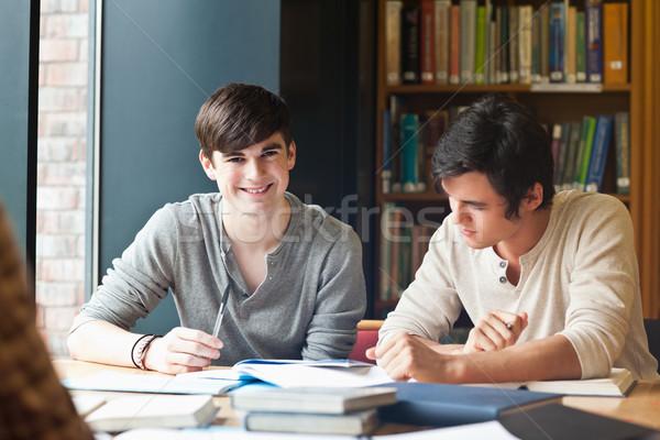 Giovani uomini studiare biblioteca lavoro Università note Foto d'archivio © wavebreak_media