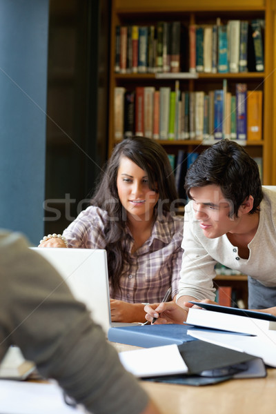 Portrait of smiling students working together in a library Stock photo © wavebreak_media