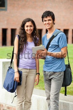 Portrait of a couple using a tablet computer outside a building Stock photo © wavebreak_media
