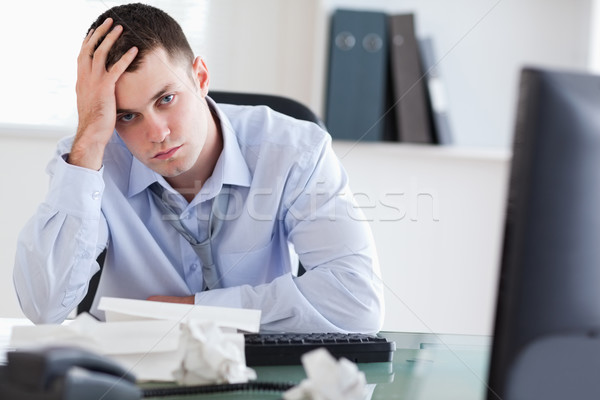 Close up of frustrated young businessman doing his accounting Stock photo © wavebreak_media