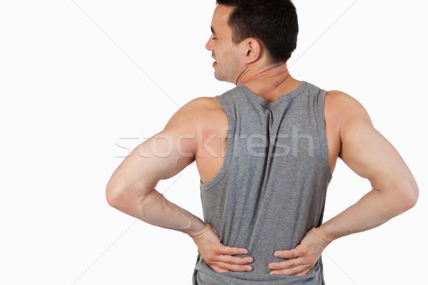 Man having a back pain against a white background Stock photo © wavebreak_media