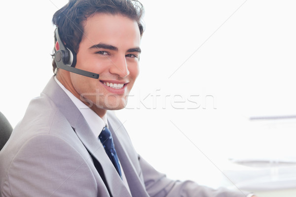 Side view of smiling young businessman with headset on Stock photo © wavebreak_media