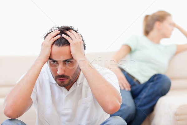 Angry couple mad at each other in their living room Stock photo © wavebreak_media