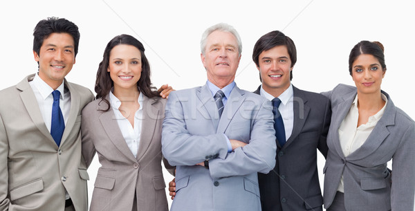Smiling young businessteam with their mentor against a white background Stock photo © wavebreak_media