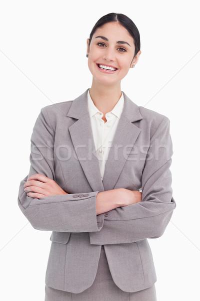 Sonriendo jóvenes vendedora los brazos cruzados blanco trabajo Foto stock © wavebreak_media