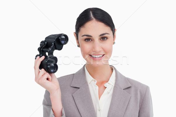 Femme d'affaires espion verres blanche travaux fond Photo stock © wavebreak_media