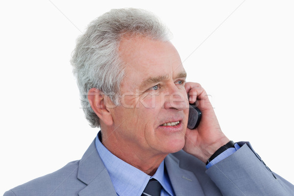 Close up side view of mature tradesman on his cellphone against a white background Stock photo © wavebreak_media