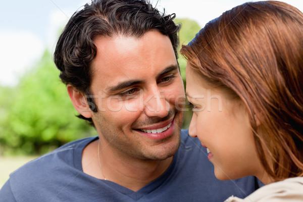 два друзей улыбаясь посмотреть глазах оба Сток-фото © wavebreak_media