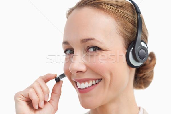 портрет деловая женщина говорить гарнитура белый улыбка Сток-фото © wavebreak_media