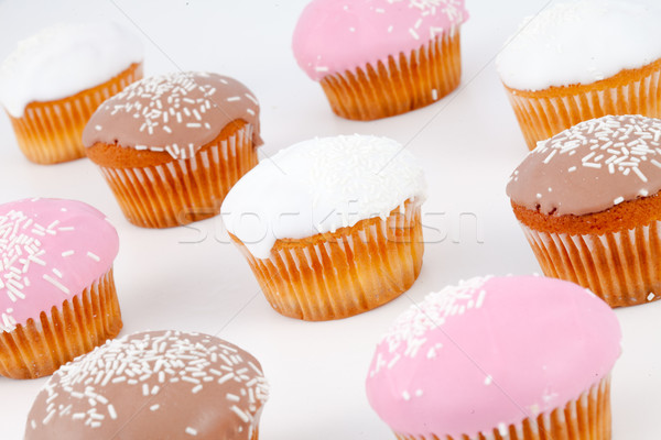 Muffins with icing sugar against a white background Stock photo © wavebreak_media