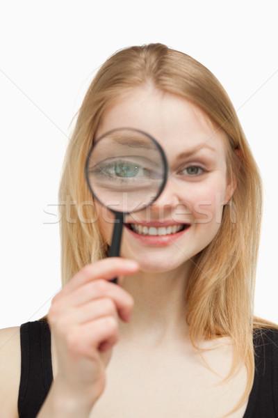 örömteli nő nagyító fehér szem női Stock fotó © wavebreak_media