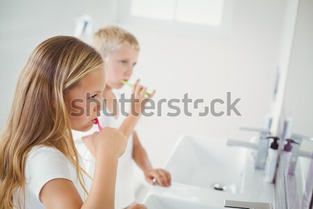Doctor auscultating the mouth of a child in an examination room Stock photo © wavebreak_media