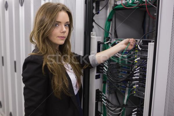 Girl working on mounted rack servers in data storage facility Stock photo © wavebreak_media
