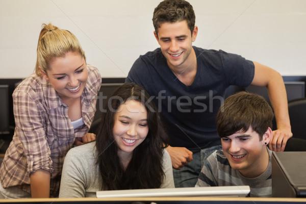 Öğrenciler oturma ayakta gülen bilgisayar kolej Stok fotoğraf © wavebreak_media