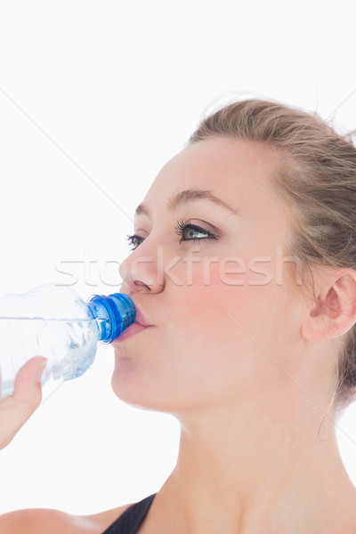 Woman drinking bottled water after doing sports  Stock photo © wavebreak_media
