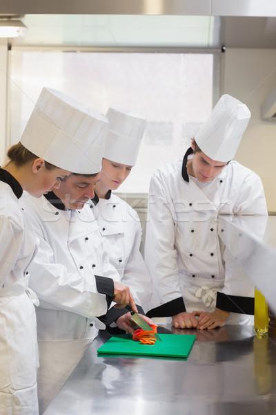 Culinaria studenti apprendimento cotoletta verdura cucina Foto d'archivio © wavebreak_media