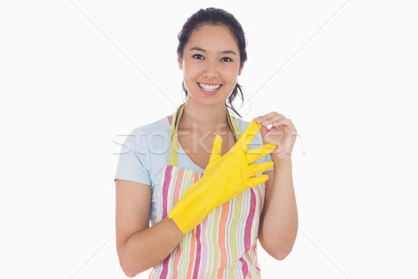 Gülümseyen kadın ayakta lastik eldiven Stok fotoğraf © wavebreak_media